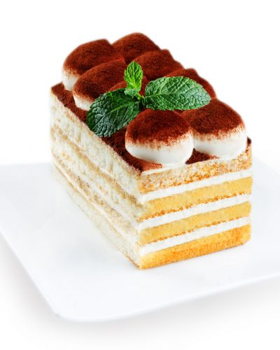 Tiramisu Cake On A White Plate Isolated
